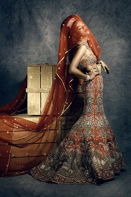Heavily embroidered red colored fish cut bridal lehenga