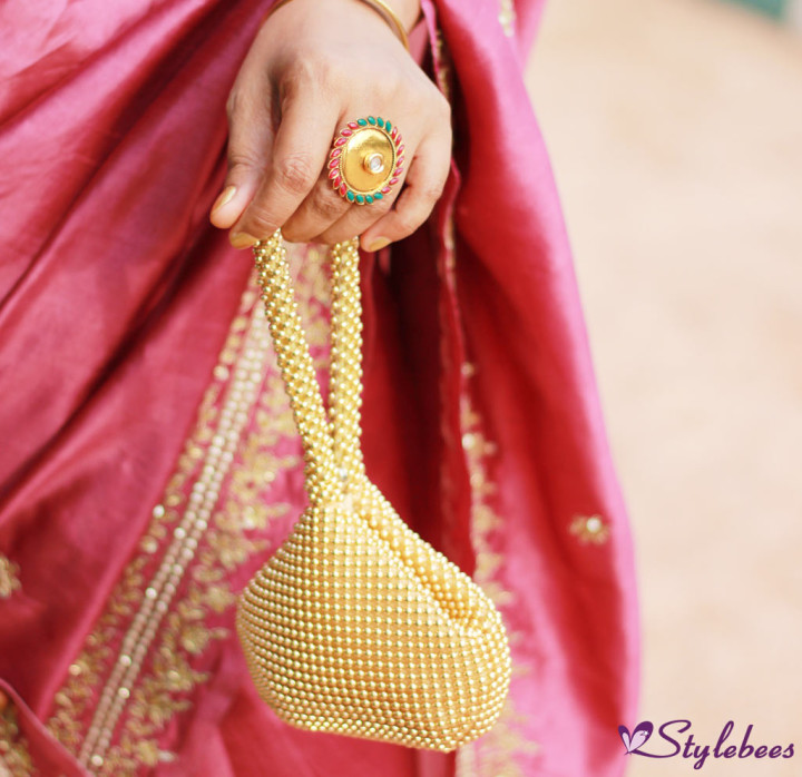 Indian attire with golden accessories