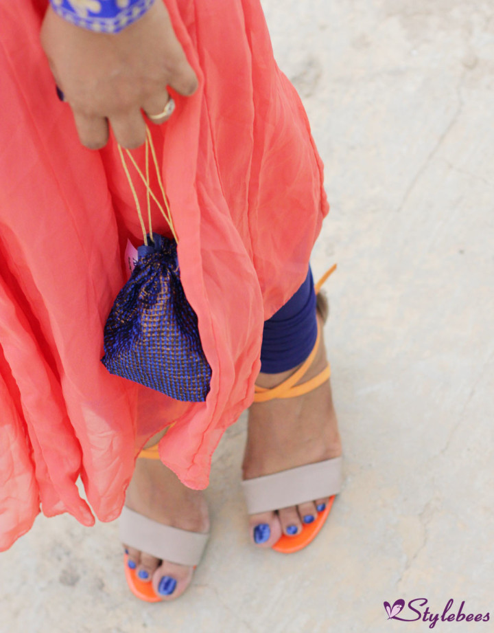 Beige and orange high heels and blue batua