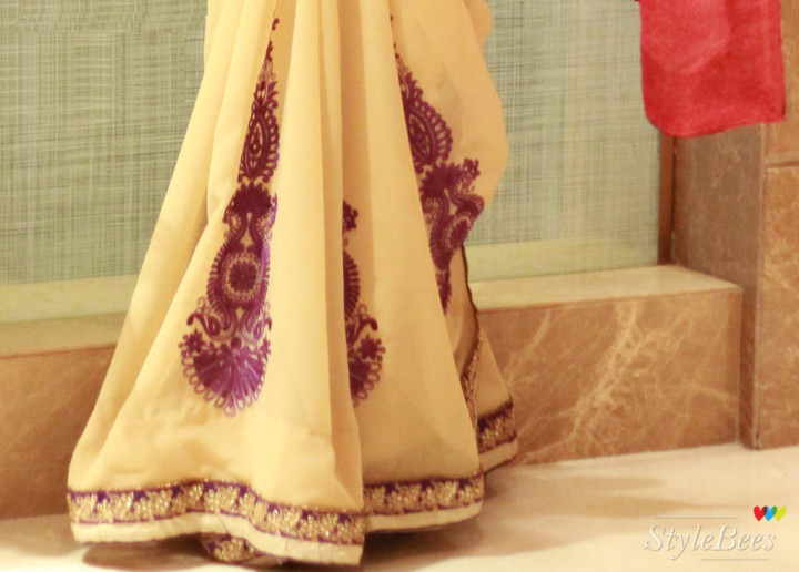 Purple color embroidery on beige and pink saree