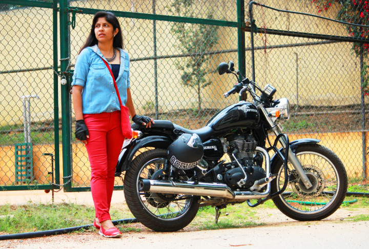 Biker girl in red jeans and blue shirt