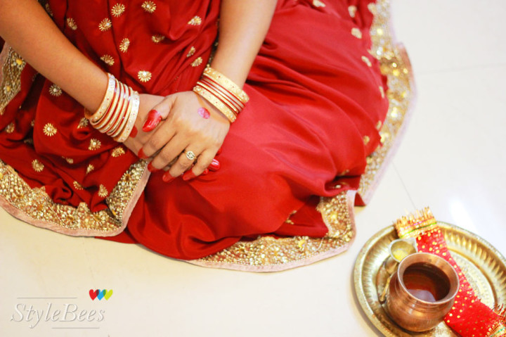 Karvachauth pooja in red and golden saree