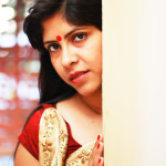 Red bindi and cream and red saree styling