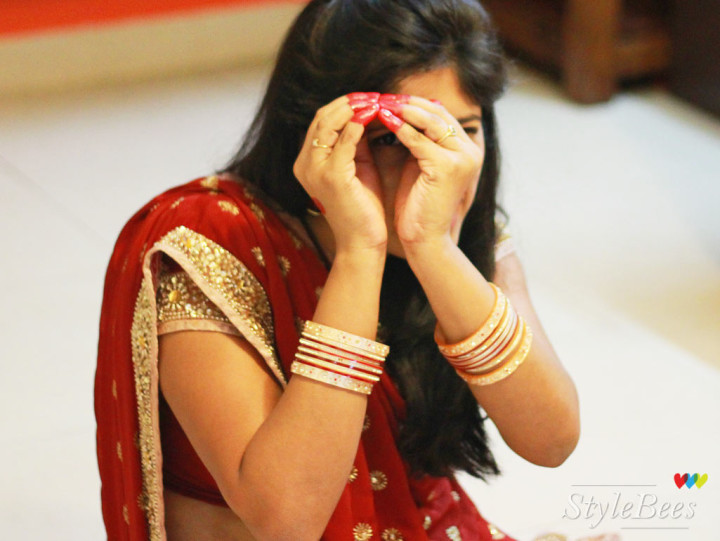 Styling for karvachauth in red saree and hand decoration with alta