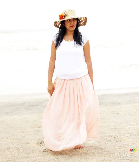 Loose top with maxi skirt on a beach