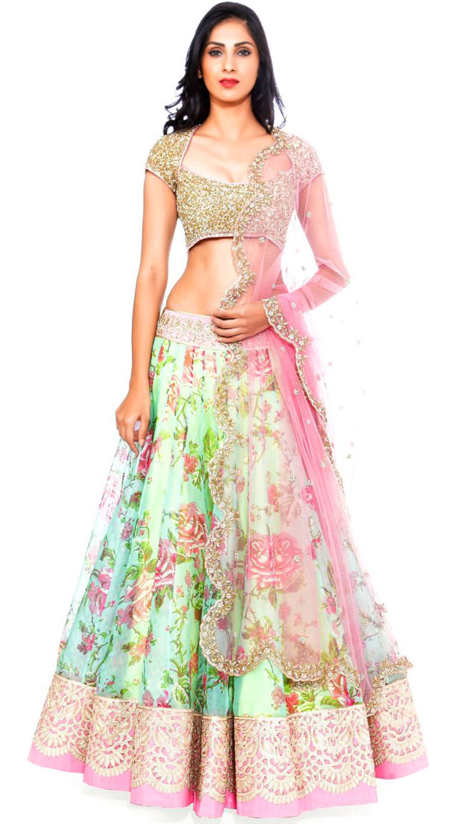 Pink and green floral print lehenga with golden choli