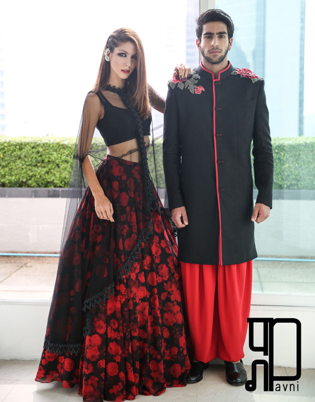 Red and black floral print lehenga with a net cape