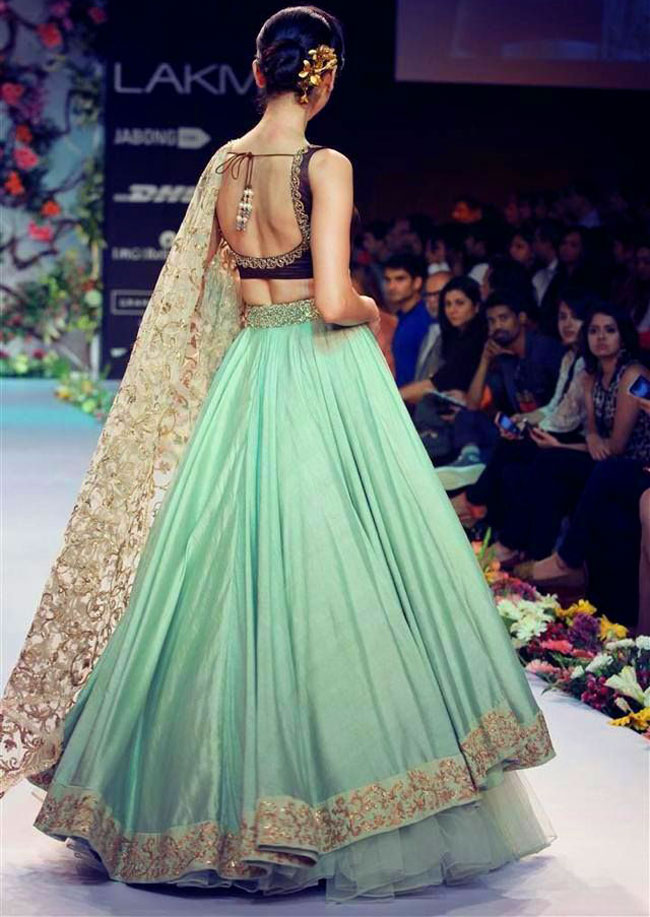 Sea green and golden color lehenga
