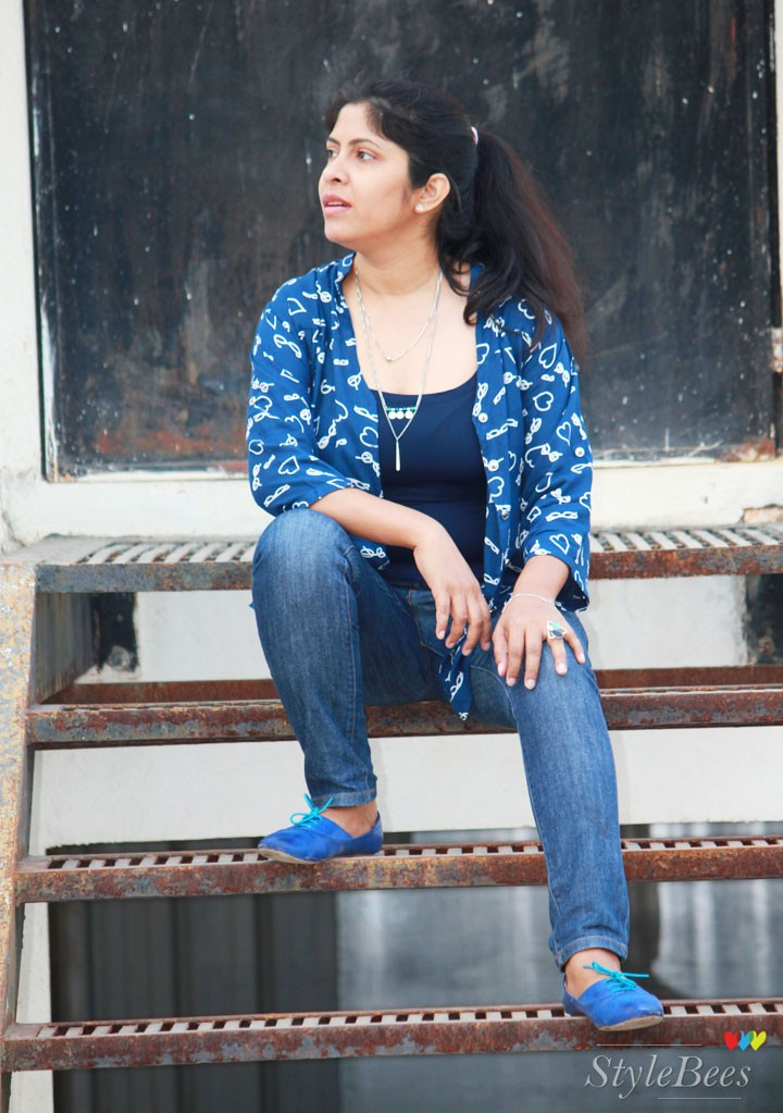 Blue jeans with blue t-shirt and shirt and shoes