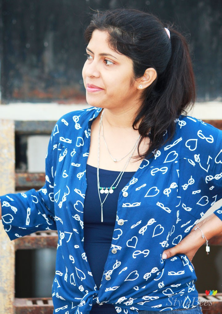Printed blue shirt with layered necklace